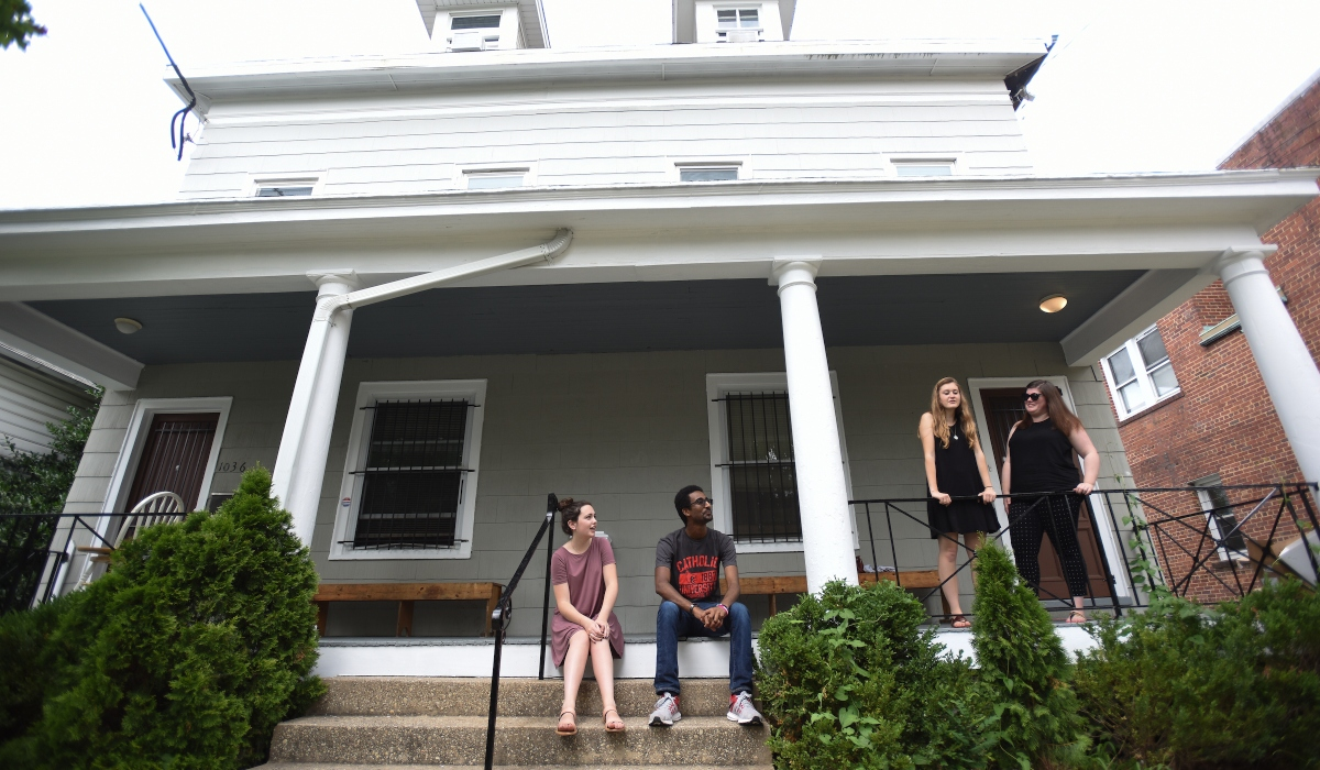 Students in front of house in Brookland
