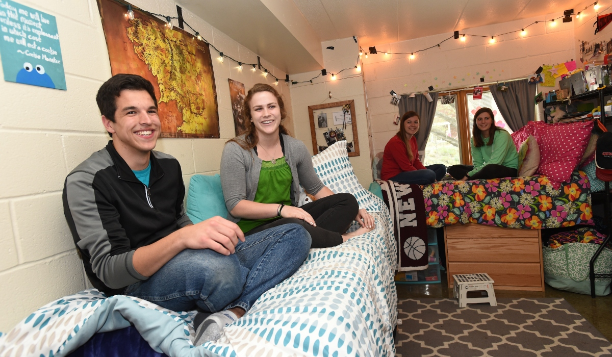 Students hanging out in residence hall room