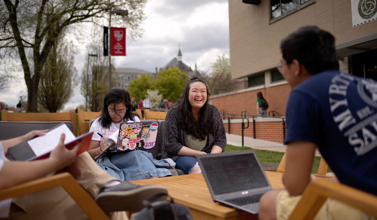 Students sitting outside in spring
